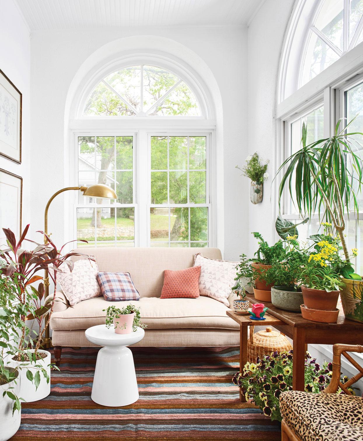 pink sofa in sunroom