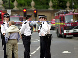 Police cordon off a road near Buckingham Palace in London after a fire broke out in the loft of the building Sunday June 2, 2002. The Palace is the center of Britain's Queen Elizabeth II's Golden Jubilee celebrations and the venue of a pop music concert scheduled for Monday. The fire was contained and there were no casualties.