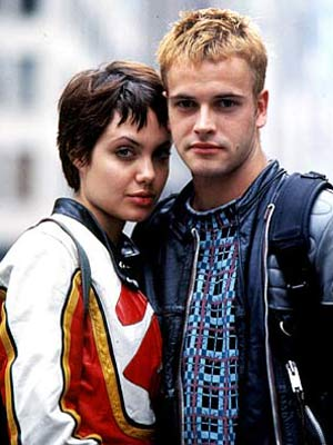 Angelina Jolie, Jonny Lee Miller | Hackers (1995) Proving that computer nerds can be sexy, a Vulcan-coiffed Jolie made her feature film breakthrough — and made costar Jonny Lee Miller her…