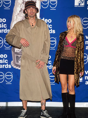 Tommy Lee, Christina Aguilera | J. Crüe Lee shows Christina Aguilera that just the right blend of dirty and pervy can make the flasher look red-carpet-ready.