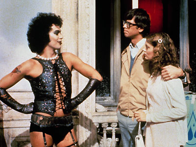 Tim Curry, Barry Bostwick, ... | Huge pearls, frizzy hair, and lace-up vest, oh my! It doesn't get much better than Dr. Frank N. Furter, who proclaims himself a ''sweet transvestite…
