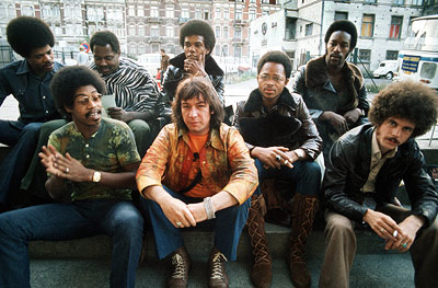 Eric Burdon & War An ''overfed, long-haired, leaping gnome'' falls asleep in the sun and dreams he's ''naked...in front of/Every kind of girl.'' Spiced with…