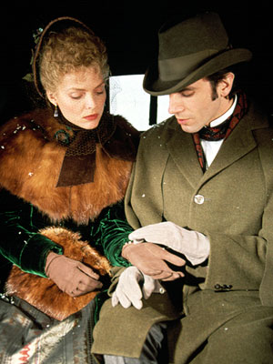 Daniel Day-Lewis unbuttons Michelle Pfeiffer 's glove in The Age of Innocence (1993).