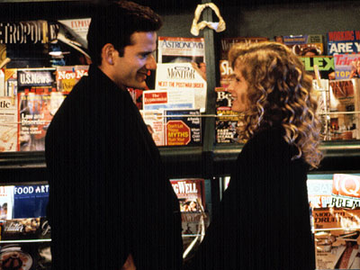 Campbell Scott gives Kyra Sedgwick a garage door opener in Singles (1992).