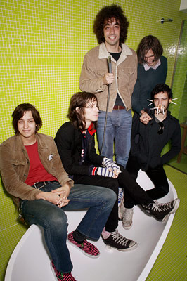 The Strokes | Why are entire cities filled with hipsters wearing blazers, rocker tees, and skinny jeans? Blame this band.