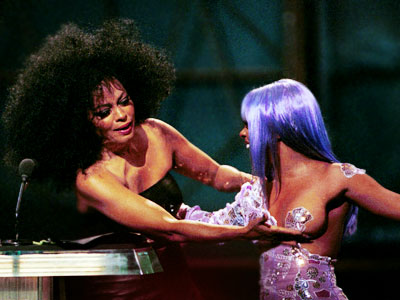 Lil' Kim, Diana Ross   The Good DIANA ROSS and LIL' KIM (1999) It was no surprise to anyone that Lil' Kim would show up to an awards show wearing…