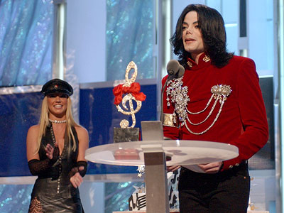 Britney Spears, Michael Jackson, ...   The Bad MICHAEL JACKSON (2002) Clad in her best S&M attire, Britney Spears presented the King of Pop with a birthday cake and recognition on…