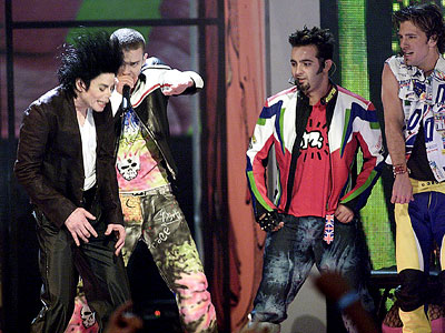 The Good 'N SYNC and MICHAEL JACKSON (2001) After a brightly colored, somewhat silly, and maybe slightly pitchy performance of ''Pop,'' the current princes of…