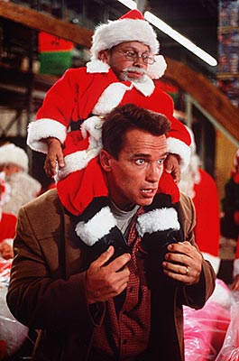Verne Troyer, Arnold Schwarzenegger, ... | Arnold Schwarzenegger wants to buy his kid the coveted Turbo-Man action figure for Christmas; unfortunately, so does every other dad in town. Foolish fathers —…