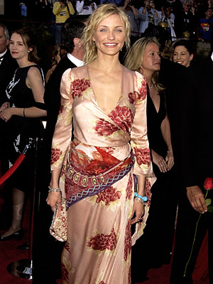 Oscars 2002, Cameron Diaz | Cameron Diaz (2002) This awkwardly belted, unfortunately accessorized gown was only made worse by the actress' fresh out of bed head.