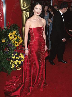 Oscars 1999, Catherine Zeta-Jones | Catherine Zeta-Jones (1999) Picking another perfect hue, this fire-red Versace certified the Zorro star a bonafide siren.