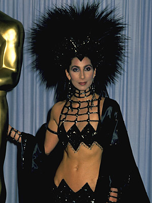 Oscars 1986, Cher | Cher (1986) The actress who elevated worst-dressing to an art form reached her pinnacle in this spider-headdressed Bob Mackie creation.