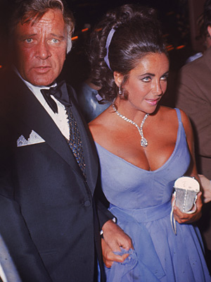Elizabeth Taylor | Elizabeth Taylor (1970) Proving the power of the dress, Taylor's plunging violet gown highlighted her violet eyes — and ensured everyone else's were on her.