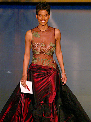 Oscars 2002, Halle Berry | Halle Berry (2002) Carrying on the great tradition of netting (and strategically placed flowers) Berry's gown proved the star-making power of Oscar's red carpet —…