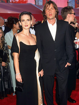 Oscars 2000, Winona Ryder | Winona Ryder (2000) Once the face of slacker chic, turning up in this '40s-era Pauline Trigere vintage gown took the actress from grunge to glamour.
