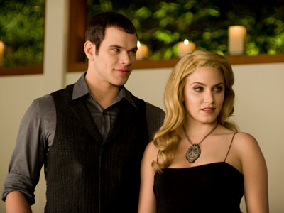 The Twilight Saga: New Moon | Emmett (Kellan Lutz) and reluctant Rosalie (Nikki Reed) are ready for Bella's birthday party. For the record, we prefer his gift, a sound system for…