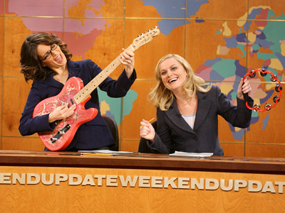 Tina Fey, Amy Poehler, ...   For the first time in SNL 's almost 40-year history, two women held down the Weekend Update desk, and they killed it. Fey brought a…