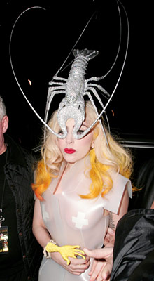 Lady Gaga | Claws célèbre: The singer rocks a massive headpiece shaped like a bedazzled lobster. Bib not included.