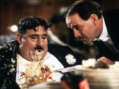 John Cleese, Monty Python's The Meaning of Life | The Pythons were just as comfortable with a gross-out gag as they were with Proust. Witness the vomiting Mr. Creosote in The Meaning of Life…