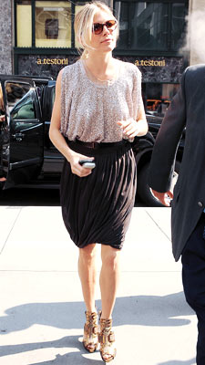 Sienna Miller | WEARING: Derek Lam On her way to the show, Joe 's Baroness shimmered and stunned in a blousy, sequined ensemble. Grade: A