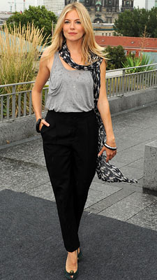 Sienna Miller | WEARING: Various At a photo call, Miller played it cool and casual in a slouchy Kain top and Chloè slacks. Grade: B