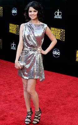 Selena Gomez | The elegant draping keeps Selena's silver dress from crossing over into disco ball territory. Grade: B