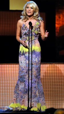 Carrie Underwood | On anybody else this distinctive watercolor gown by Tracy Reese could have been a contender for the worst dressed list, but Underwood provided the perfect…