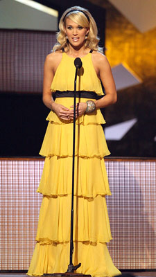 Carrie Underwood | A fun, yellow floor-length halter dress was the perfect combination of elegance and playfulness. A-