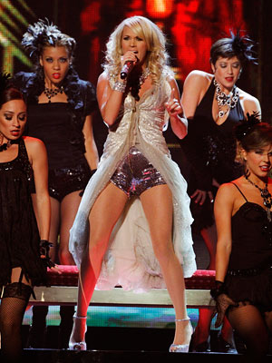 Carrie Underwood | Underwood does! Between the sequin short-shorts and her metallic dress-vest, Underwood's getup for her performance of ''Cowboy Cassanova'' was all parts wrong. D+