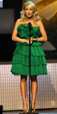Carrie Underwood | Keeping with her ruffle theme, Underwood sported an emerald three-tiered cocktail dress by Ina Soltani. With the brilliant color and the avant neckline, what's not…