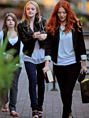 Dakota Fanning, The Twilight Saga: New Moon | New cast member Dakota Fanning walks with fellow vampire Rachelle Lefevre .