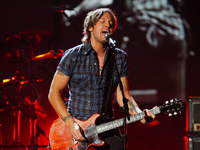 Keith Urban | KEITH URBAN He kissed a girl, and he liked it. Country?s reigning Aussie turns out a tight, rollicking version of his country-crossover hit ''Kiss a…