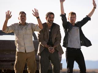 Ewan McGregor, George Clooney, ...   WE SURRENDER George Clooney, Waleed Zuaiter, and Ewan McGregor in the desert in The Men Who Stare at Goats