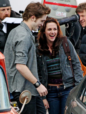 Kristen Stewart, Robert Pattinson, ... | Cameras first rolled on The Twilight Saga: New Moon in Vancouver, where Pattinson and Stewart shared this laugh on set.