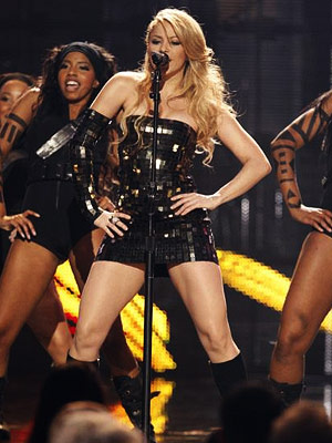Shakira | SHAKIRA Shades of ''Hollaback Girl'' in the spirit-squad intro and a cappella call-and-response, plus ''Single Ladies'' black leotards for the backup dancers. Still, Shakira makes…