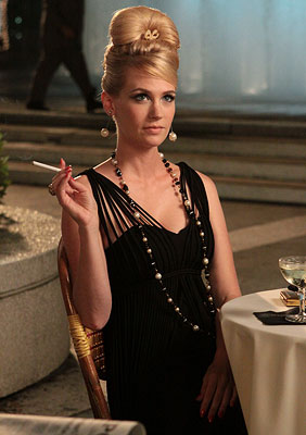 Mad Men, January Jones | JANUARY JONES As Mad Men housewife Betty, Jones showed us the noir side of her impeccably tailored wardrobe with this sexy ensemble during the Drapers'…