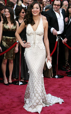 Marion Cotillard   Marion Cotillard's Oscar dress [in 2008] was show-stopping and completely unique, unlike anything ever seen at the Academy Awards. — Mary Jane