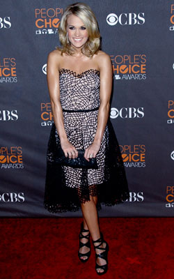 Carrie Underwood | CARRIE UNDERWOOD Taking a break from her usually glitzy garb , nominee Carrie Underwood pulled off this elegant netted Christian Cota dress that was equal…