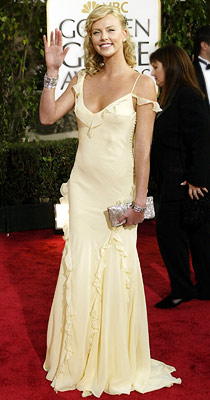 Golden Globe Awards 2004, Charlize Theron | Charlize Theron in 2004 Between her soft curls and the delicate ruffles of her lemon yellow Dior, the Monster star was pure fairytale romance.