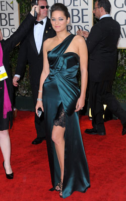 Golden Globe Awards 2010 | MARION COTILLARD Cotillard showed off a lot of leg — and a little lingerie — with this structured Christian Dior gown. Grade: B+