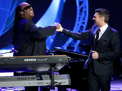 American Idol, Stevie Wonder   You need a guy to do this, or you'll lose the ''guy'' audience. How about someone like Stevie Wonder? What a talent. — mewnormick