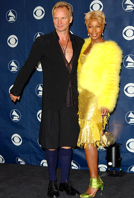 Sting, Mary J. Blige | Wait, why is he wearing navy knee socks?! Snuffy and Big Bird sure did grow up to be weird.