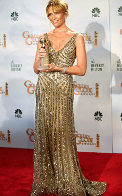 Golden Globe Awards 2010 | TONI COLLETTE The Globe winner sparkled in a slinky Elie Saab gown that dripped in gold beading. Grade: A
