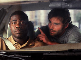 Cop Out, Bruce Willis, ... | ONE MORE THING, OFFICER Seann William Scott tries to get Tracy Morgan's attention in Cop Out