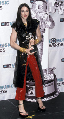 Madonna   Madonna at the MTV Video Music Awards, Sept. 1998 Always one to switch up her style, Madonna went for a full-on sequin McQueen ensemble at…