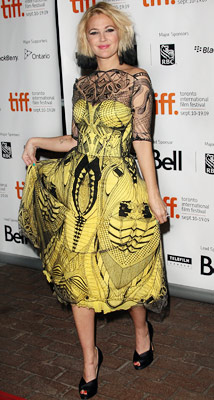 Drew Barrymore   Drew Barrymore at the Toronto Film Festival, Sept. 2009 Fashion chameleon Barrymore went for glamorous and punk-rock at the same time in this tattooed confection.