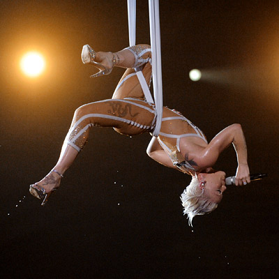Pink | PINK The trapeze acrobatics, the revealing outfit — it might have wowed first-time viewers, but we couldn't help feeling we'd seen Pink do this routine…