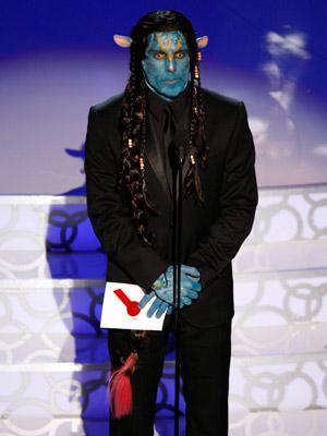 BEN STILLER WORKS BLUE Stiller presented the Best Makeup award in blue facepaint, braids, and pointy ears, speaking (at length) in Na'vi, before telling Avatar…