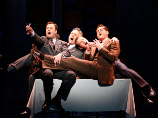 PROMISES, PROMISES Broadway revival shifts corporate world of company men chasing working girls around the office to 1962, a la Mad Men (pictured, l. to…