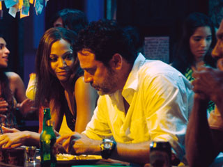 The Losers | TOUGH GUY (AND GIRL) Zoë Saldana and Jeffrey Dean Morgan play betrayed CIA black-ops agents in The Losers .